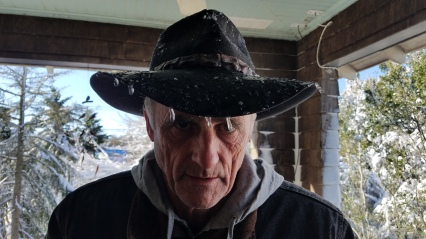 Paul with icicles on his hat from standing under melting snow and then refreezing.